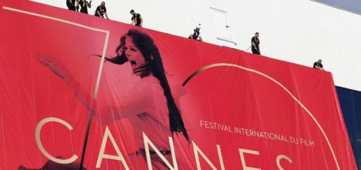 epa05965514 Workers set up the official poster of the 70th annual Cannes Film Festival on the Palais des Festivals facade, in Cannes, France, 15 May 2017. The poster displays a photogram of Italian actress Claudia Cardinale. The film festival will run from 17 to 28 May.  EPA/SEBASTIEN NOGIER